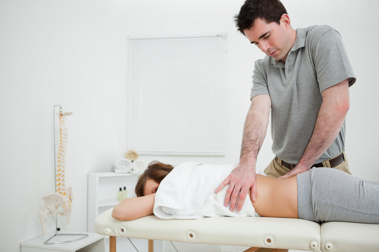 Osteopath Helping Woman Overcome Body Aches and Pains